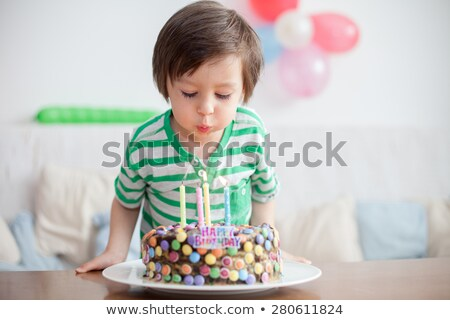 child blowing out 4 birthday candles Stock photo © godfer