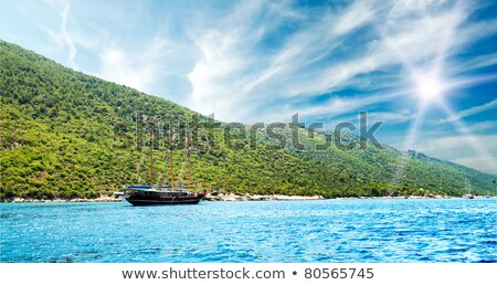 Wonderful brown yacht swimming in turquoise aegean sea. Stock photo © lypnyk2