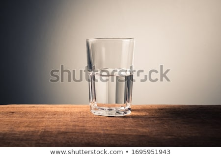 Half full glass of water Stock photo © elenaphoto