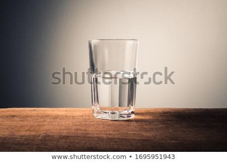 half · vol · glas · water · lege · geïsoleerd - stockfoto © elenaphoto