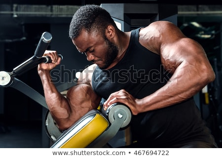 Fit body bicep muscles on african american man Stock photo © darrinhenry