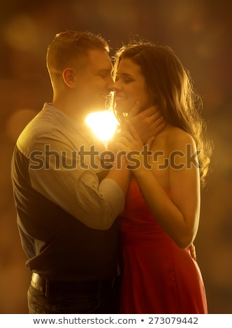 Stock photo: adorable couple in love kissing and embracing each other