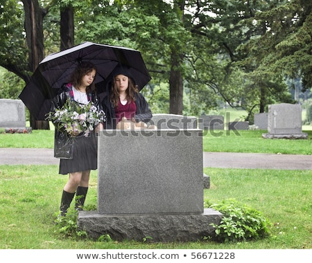 Two Sad Girls At A Grave Stock photo © stuartmiles