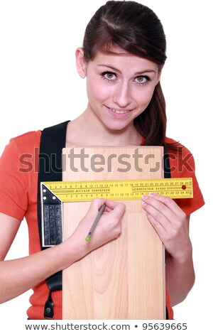 Woman measuring width of laminate flooring Stock photo © photography33