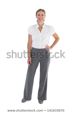 Portrait of a woman standing with her hands on her hips Stock photo © photography33