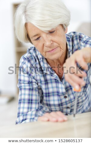 woman fixing something on a wall Stock photo © photography33