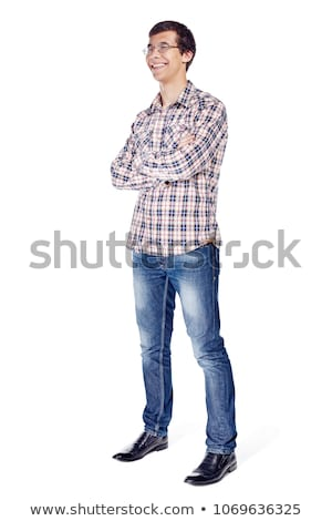 Handsome man with arms crossed looking his left on black Stock photo © dash