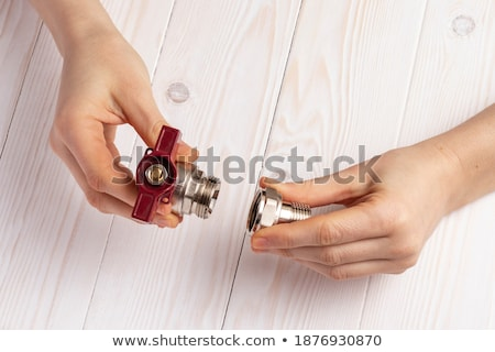 Stock photo: Plumber with pieces in the hands