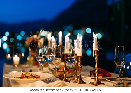 Served table in a luxury outdoor restaurant. Shallow depth of fi Stock photo © moses