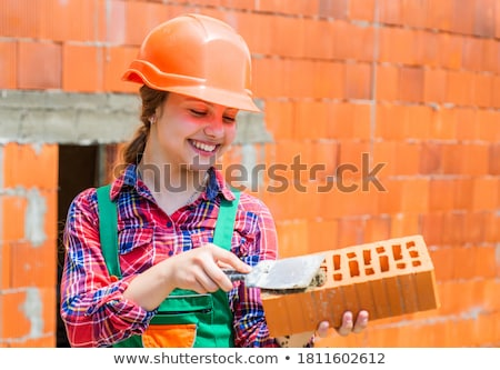 Stock photo: Little girl on a building site