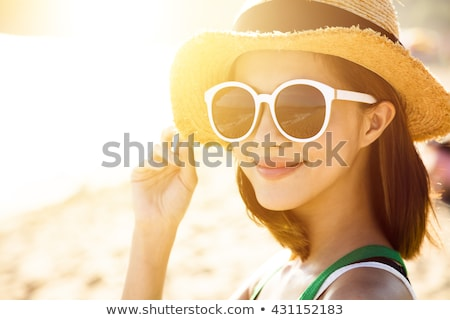 girl in a hat with a glass Stock photo © OleksandrO