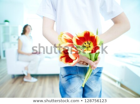 Little boy holding bunch of flowers behind his back Stock photo © photography33