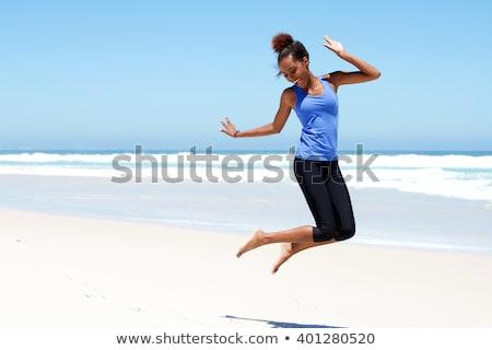 kadın · atlama · gülme · plaj · portre - stok fotoğraf © juniart
