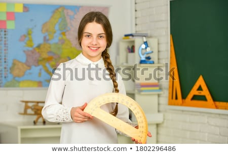 Architect holding compass and protractor Stock photo © photography33