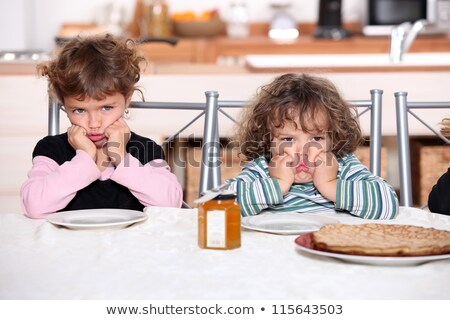Kids pouting in the kitchen Stock photo © photography33