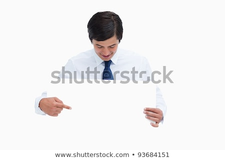 tradesman looking at blank sign in his hands against a white background stock photo © wavebreak_media
