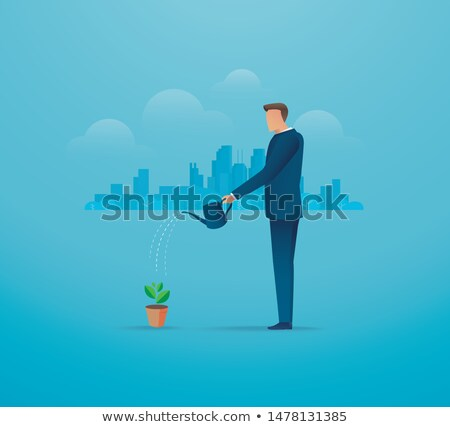 businessman watering young tree stock photo © elenaphoto