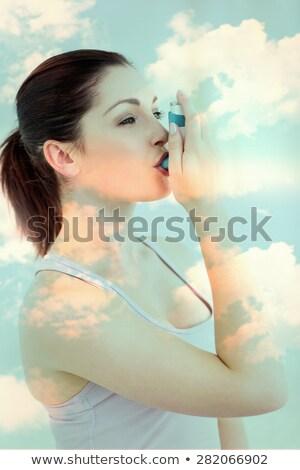 brunette using asthma inhlaer stock photo © wavebreak_media
