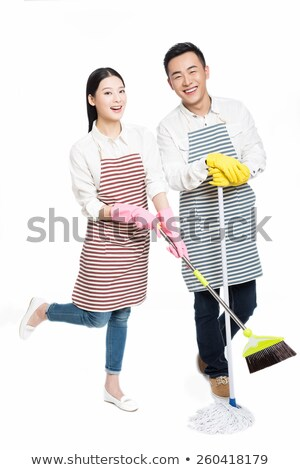 Portrait Of Smiling Young Maid Holding Sponge Stock fotó © wxin