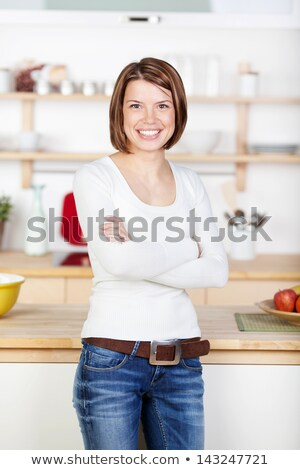 woman standing at the kitchen counter Stock photo © vichie81