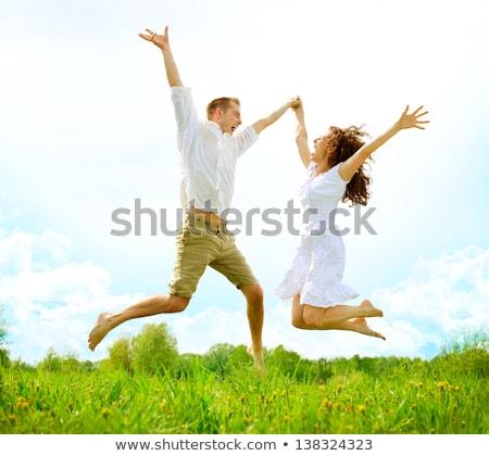 couples jump on grass stock photo © paha_l