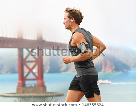 Running training music on smart phone app - runner Stock photo © Maridav