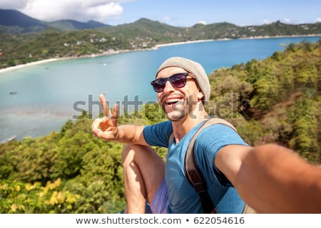 Portrait of young man in sunglasses stock photo © Kor