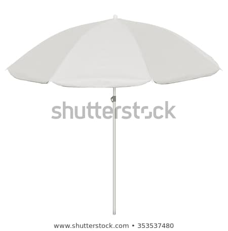 Sunshade on tropical white beach Stock photo © smithore
