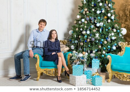 Leggy young woman sitting on a chair Stock photo © stryjek