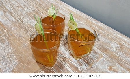 cold herb drinks serving on wood table stock photo © nalinratphi