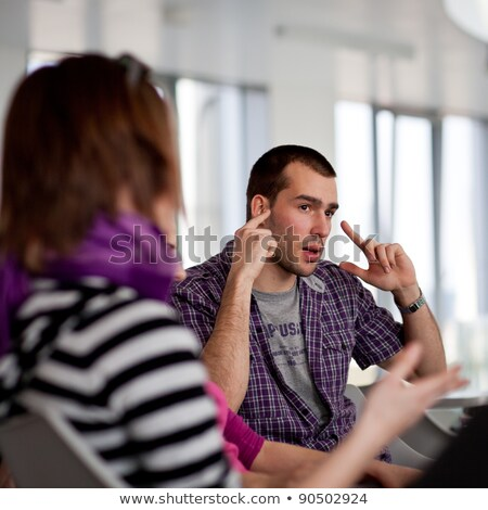 Stock photo: Student girls during a brake between classes - chatting and havi