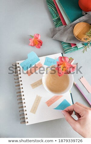 Hand writing on notepaper at coffee shop Stock photo © nalinratphi