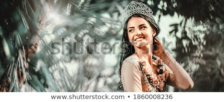 Elegant smiling lady with tiara on a head posing in a forest Stock photo © amok