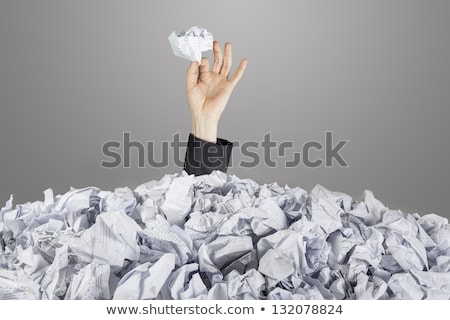 business woman under crumpled pile of papers stock photo © hasloo