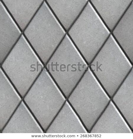gray paving slabs laid as pattern of rhombuses stock photo © tashatuvango