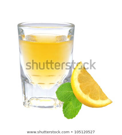 Glass of vodka with pepper, lemon slice and mint leaf isolated o Stock photo © tetkoren