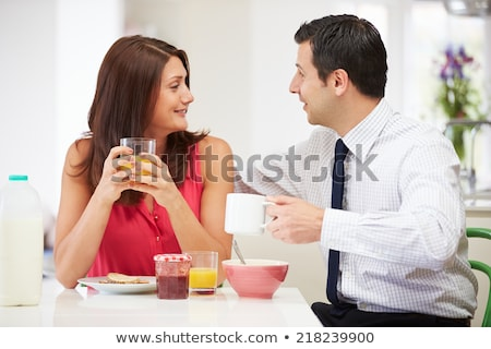 casal · café · da · manhã · trabalhar · mulher · sorrir · jornal - foto stock © ambro