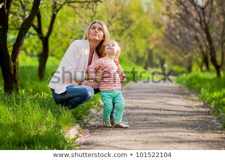 Mother and daughter in park lie on grass in spring Stock photo © Paha_L