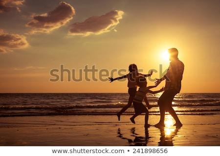 family silhouette on the beach Stock photo © illustrart