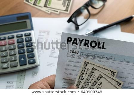 Payrolls Concept with Word on Folder. Stock photo © tashatuvango