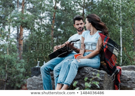Handsome young man holding acoustic guitar Stock photo © sumners