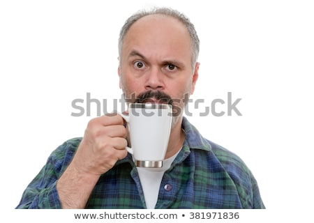 Man with glass near face and puzzled expression Stock photo © ozgur