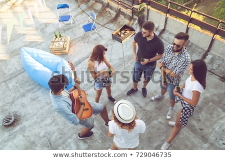 Stock photo: Attractive girl with guitar, high angle view