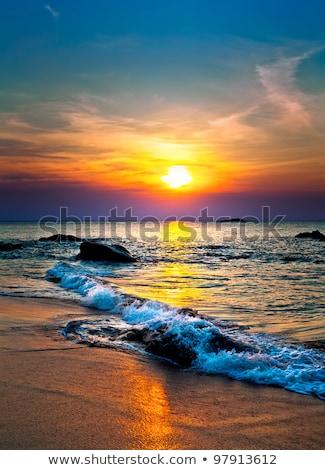 Hullámok fehér naplemente kövek gyönyörű puha Stock fotó © morrbyte