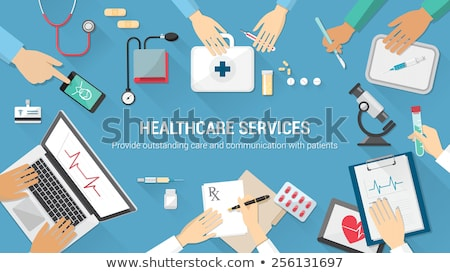 Doctor hands with microscope and pills. Stock photo © Kurhan