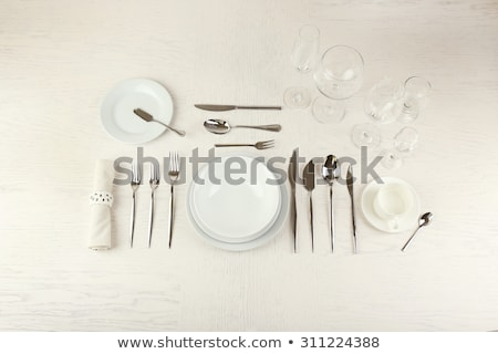 close up of table setting with glasses and cutlery Stock photo © dolgachov