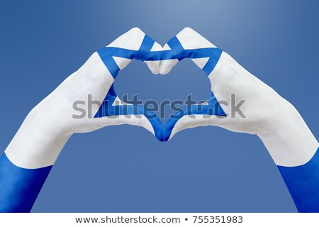 hands patterned with the flag of Israel Stock photo © nito