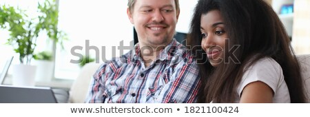 portrait of a happy afroamerican woman on a sofa Stock photo © Giulio_Fornasar
