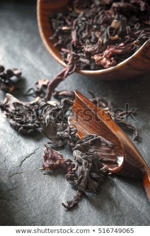 Hibiscus tea in the wooden bowl on the dark stone background top view Stock photo © Karpenkovdenis