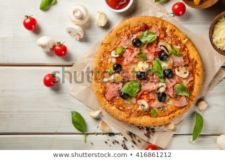 Pizza with meat, tomatoes and olives stock photo © Yatsenko